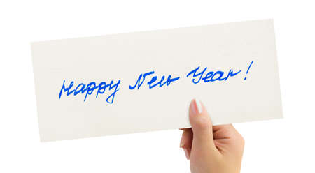 New Year greeting card in hand isolated on white background photo