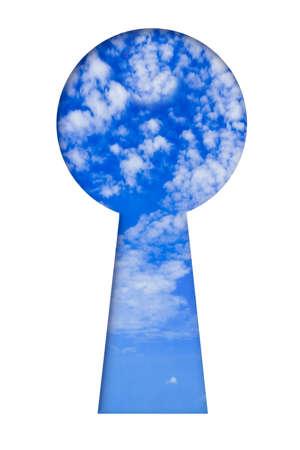 Sky in keyhole isolated on white background photo