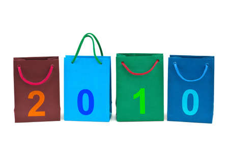 Shopping bags and numbers 2010 isolated on white background photo