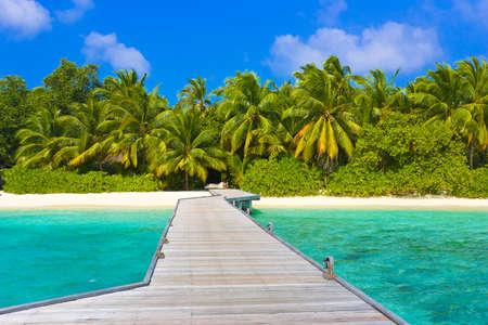 Jetty, beach and jungle - vacation background Stock Photo