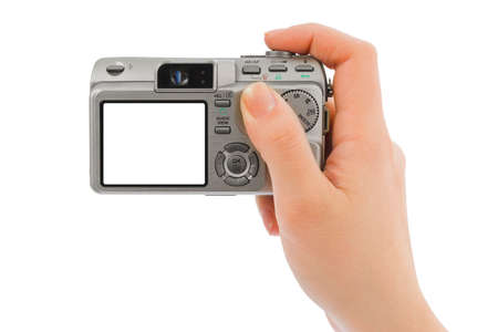 Photo camera in hand isolated on white background photo