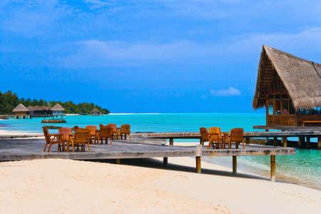 Cafe on the beach, ocean and sky photo