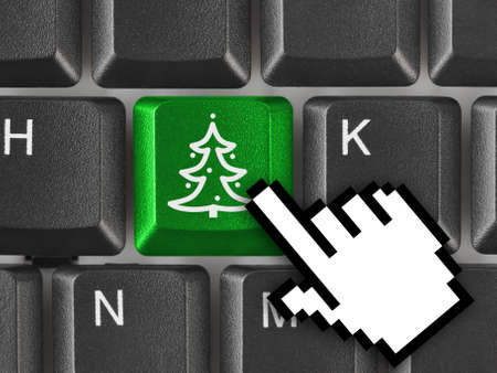 Computer keyboard with Christmas tree key - holiday concept Stock Photo - 6102519