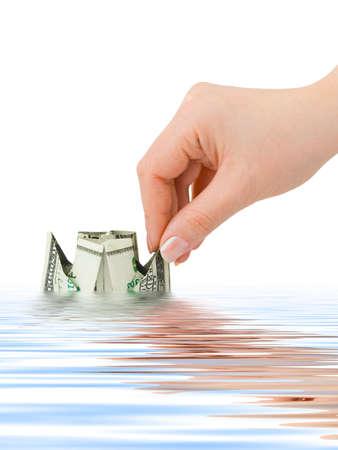 Hand launching money ship isolated on white background Stock Photo - 6189325