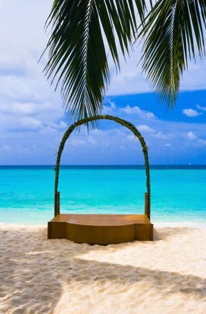 Wedding archway at tropical beach - holiday background photo