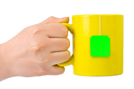Hand with cup of tea cup of tea isolated on white background photo