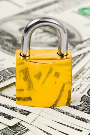 Money and lock - business security background photo