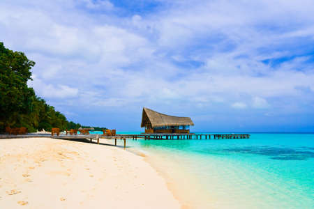 Cafe on the beach and diving club at a tropical island photo