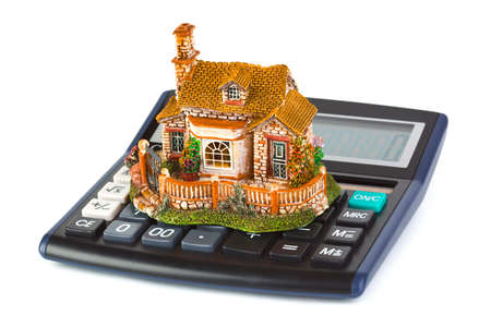 Calculator and house isolated on white background photo