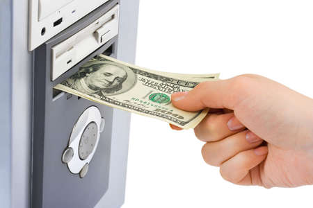 Hand with money and computer isolated on white background photo