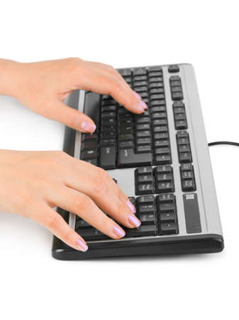 Computer keyboard and hands isolated on white background photo