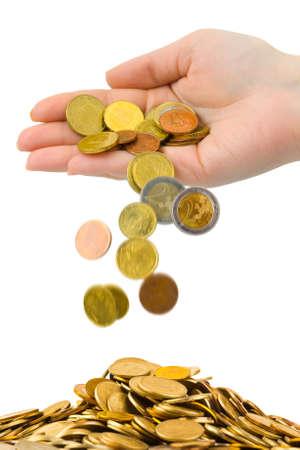cash in hand: Mano y monedas ca�das aisladas sobre fondo blanco