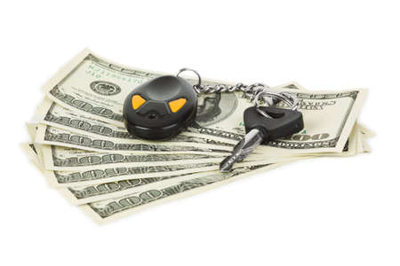Car keys and money isolated on white background photo