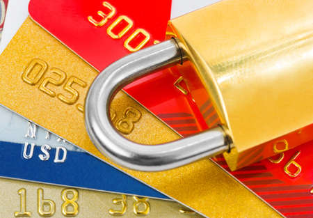Credit cards and lock - business security background photo