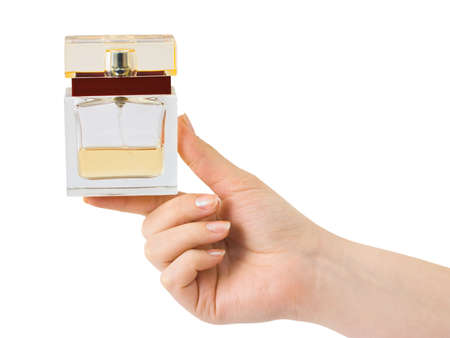 Hand with perfume isolated on white background photo