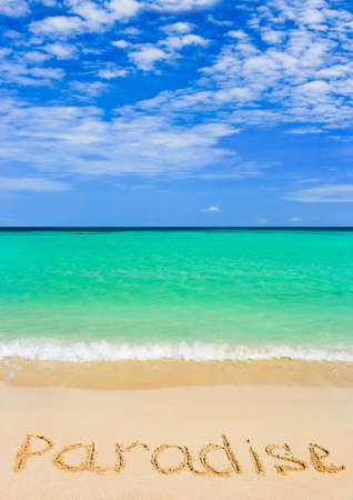 Word Paradise on beach - concept travel background photo