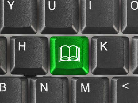 Computer keyboard with Book key - education background photo