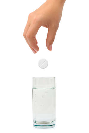 Hand, pill and water glass isolated on white background photo