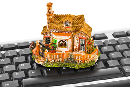 House on computer keyboard - isolated on white background photo
