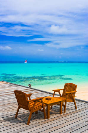 Cafe on the beach, ocean and sky - vacations background photo