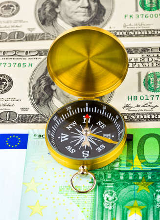 Compass and money - concept business background photo