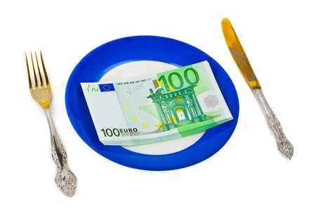 Money on plate isolated on white background photo