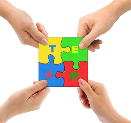Hands and puzzle Team isolated on white background Stock Photo - 6696019