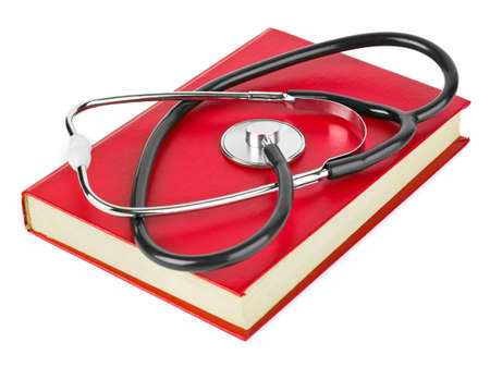 Stethoscope and book isolated on white background photo