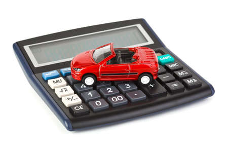 calculator money: Calculator and toy car isolated on white background