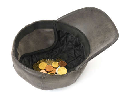 destitution: Cap with money isolated on white background Stock Photo