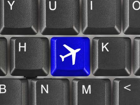 Computer keyboard with Plane key - technology background photo
