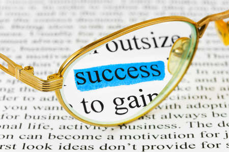 Glasses on business article and word success Stock Photo - 7025517