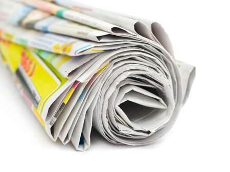 broadsheet newspaper: Roll of newspapers isolated on white background
