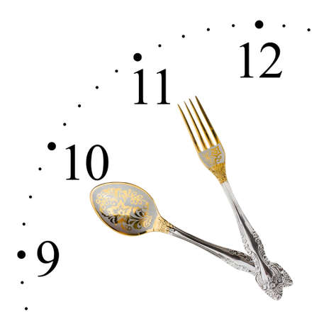 Clock made of spoon and fork isolated on white background Stock Photo - 7057292