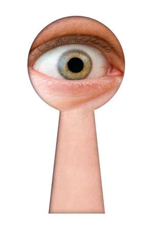 Eye in keyhole isolated on white background photo