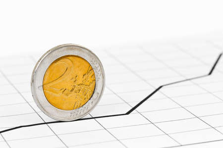 trundle: Rolling coin and diagram - abstract business background Stock Photo