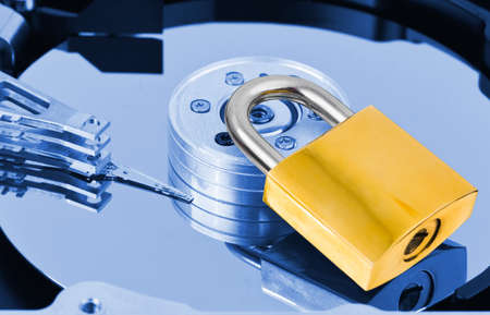 harddrive: Computer harddrive and lock - security concept background Stock Photo