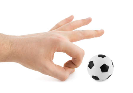 Hand and soccer ball isolated on white background photo