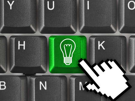 Computer keyboard with lamp key - technology background photo