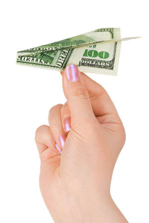 Hand and money plane isolated on white background photo