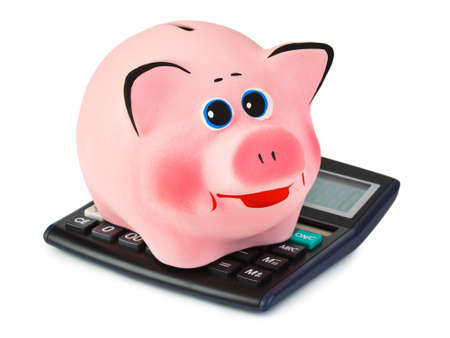 Calculator and piggy bank isolated on white background photo