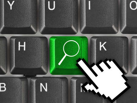 Computer keyboard with search key - business concept Stock Photo - 7199759