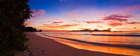 Tropical island at sunset - nature background photo