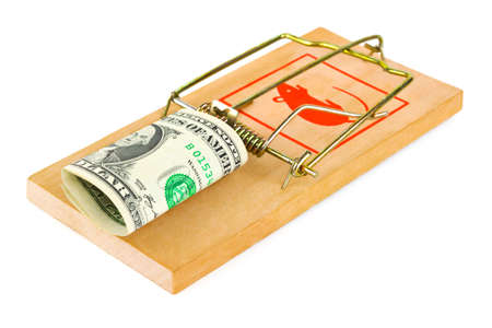 Mousetrap and money isolated on white background photo