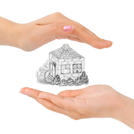 Cupped hands and house isolated on white background photo