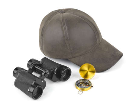 Binoculars, compass and cap - travel concept Stock Photo - 7376962