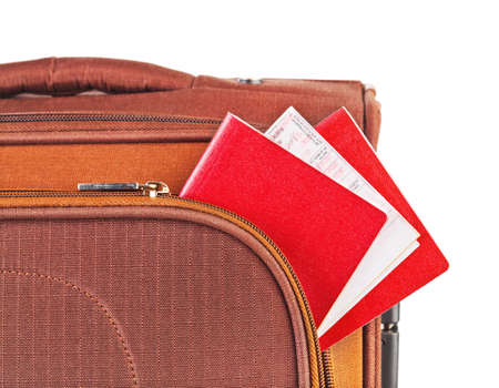 Travel case, passport and ticket isolated on white background photo