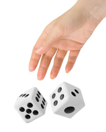 Hand throwing two big dices isolated on white background photo