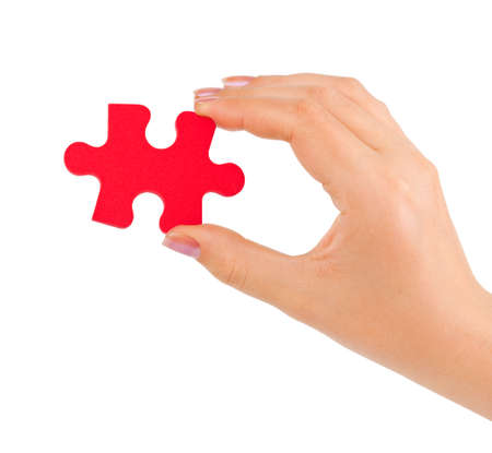 Hand with puzzle isolated on white background Stock Photo - 7419173