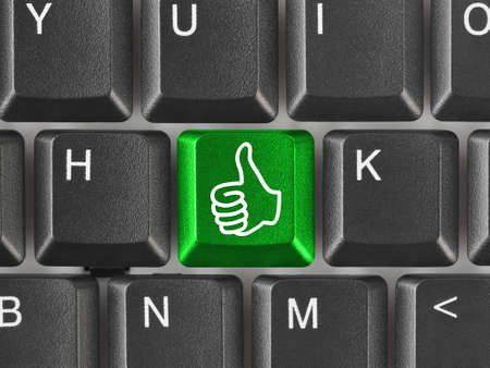 Computer keyboard with thumb gesturing hand key Stock Photo - 7463211